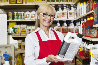 woman holding can in retail store